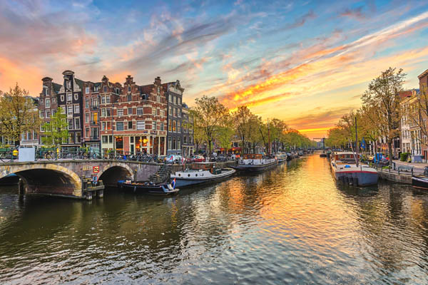 Amsterdam sunset city skyline at canal waterfront Amsterdam Netherlands